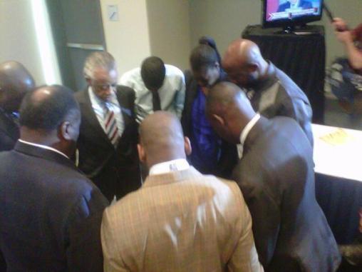 Trayvon family in prayer
